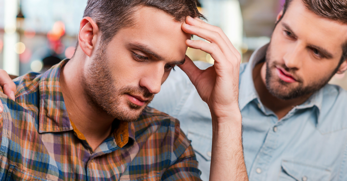 man looking upset friend comforting, what to do when make mistake